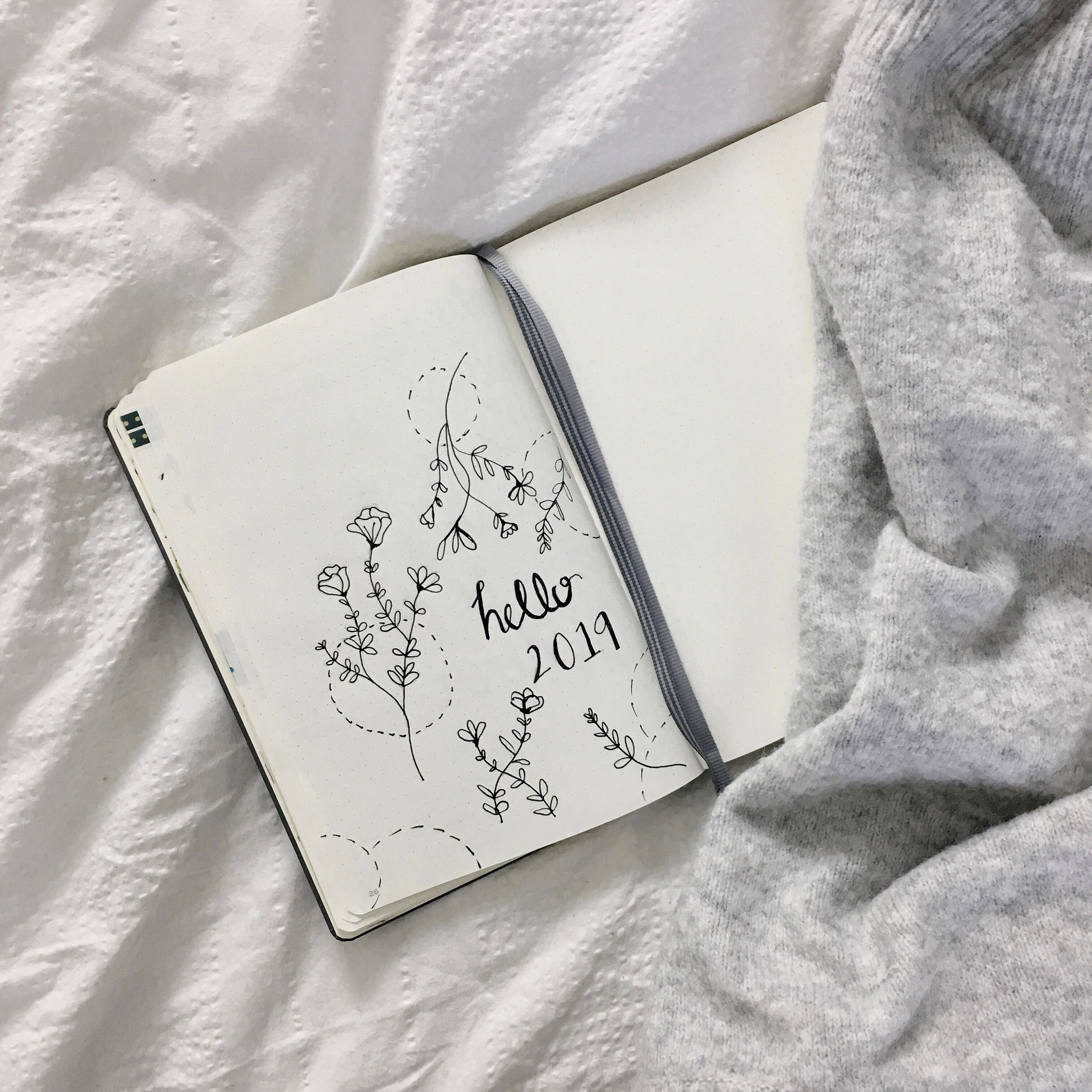 2019 bullet journal spread on a bed