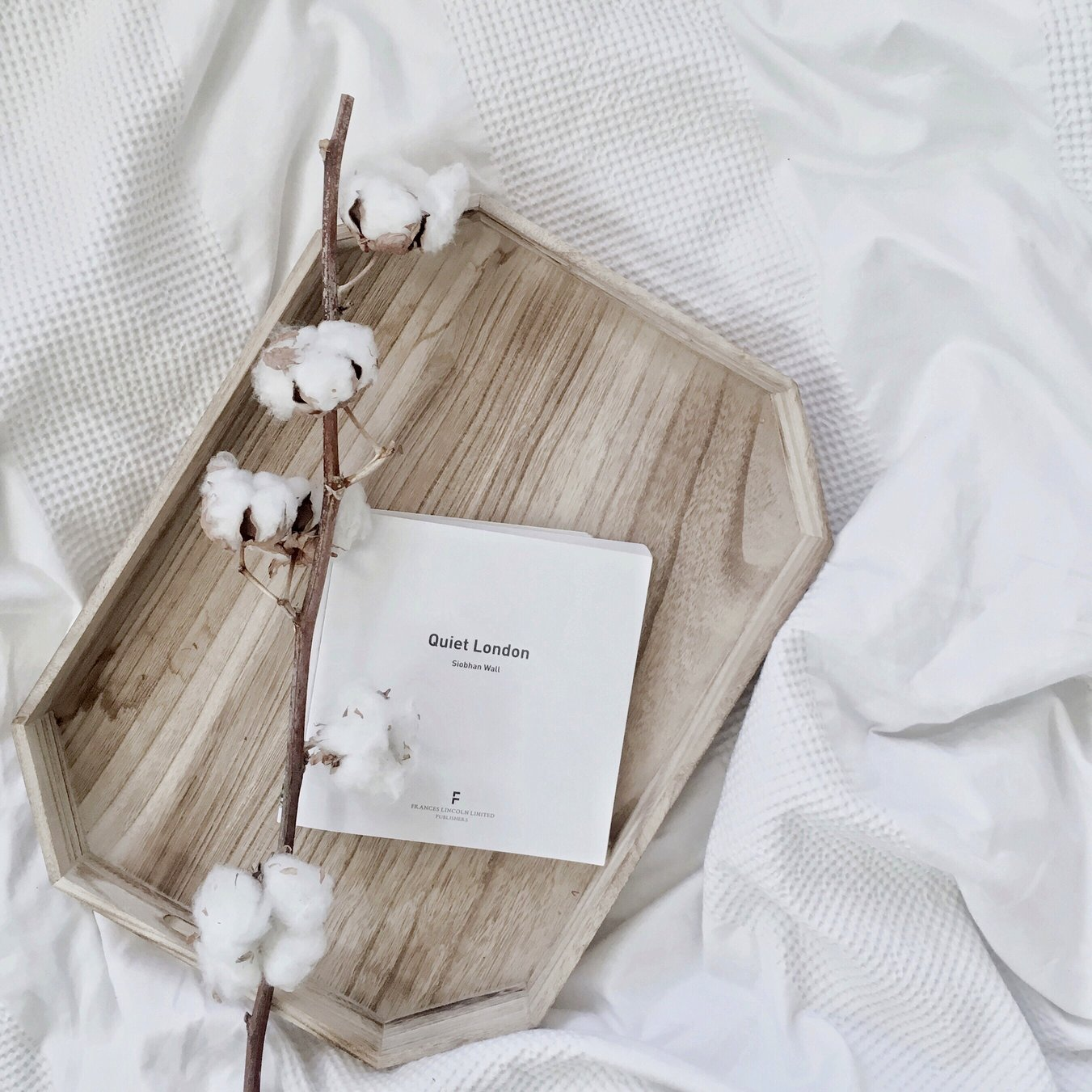 Flat lay with cotton flowers and Quiet London book