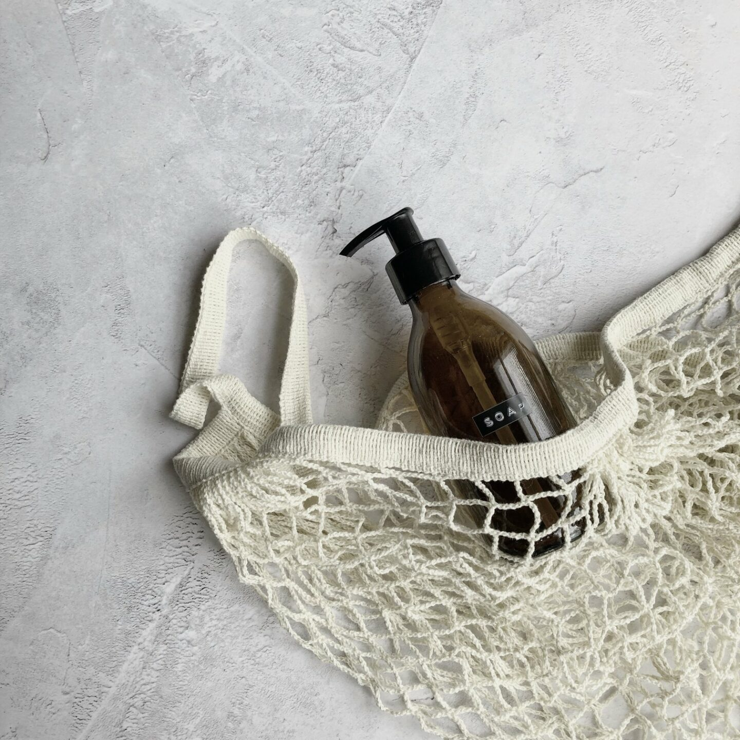 Reusable string bag and refillable glass bottle
