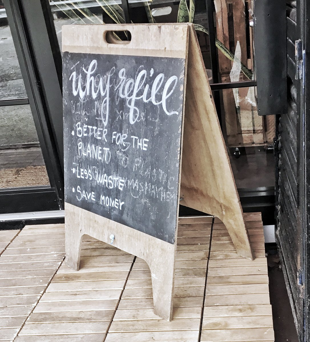 Why refill? Sign explaining the reasons for going plastic packaging free