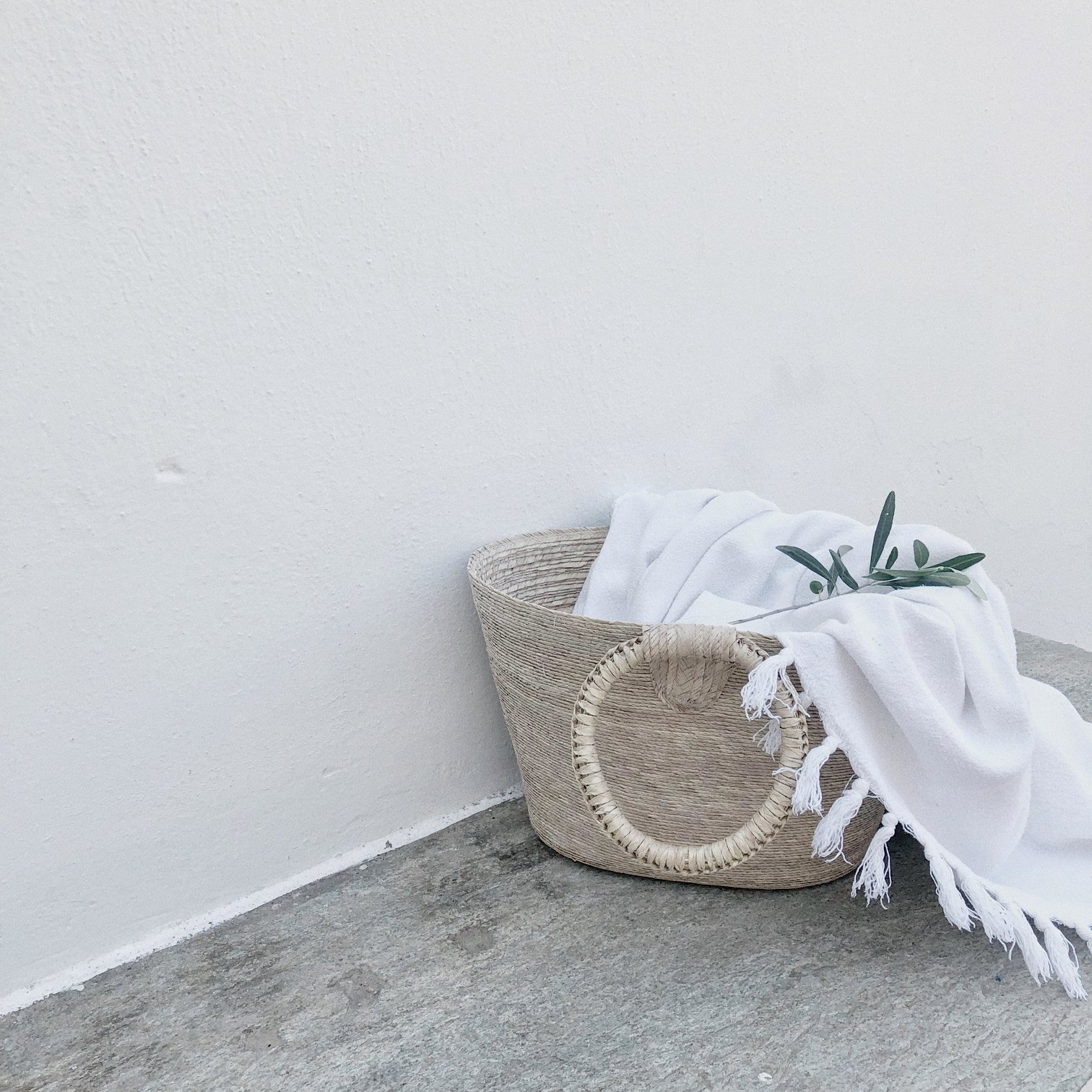 Woven basket bag with blanket