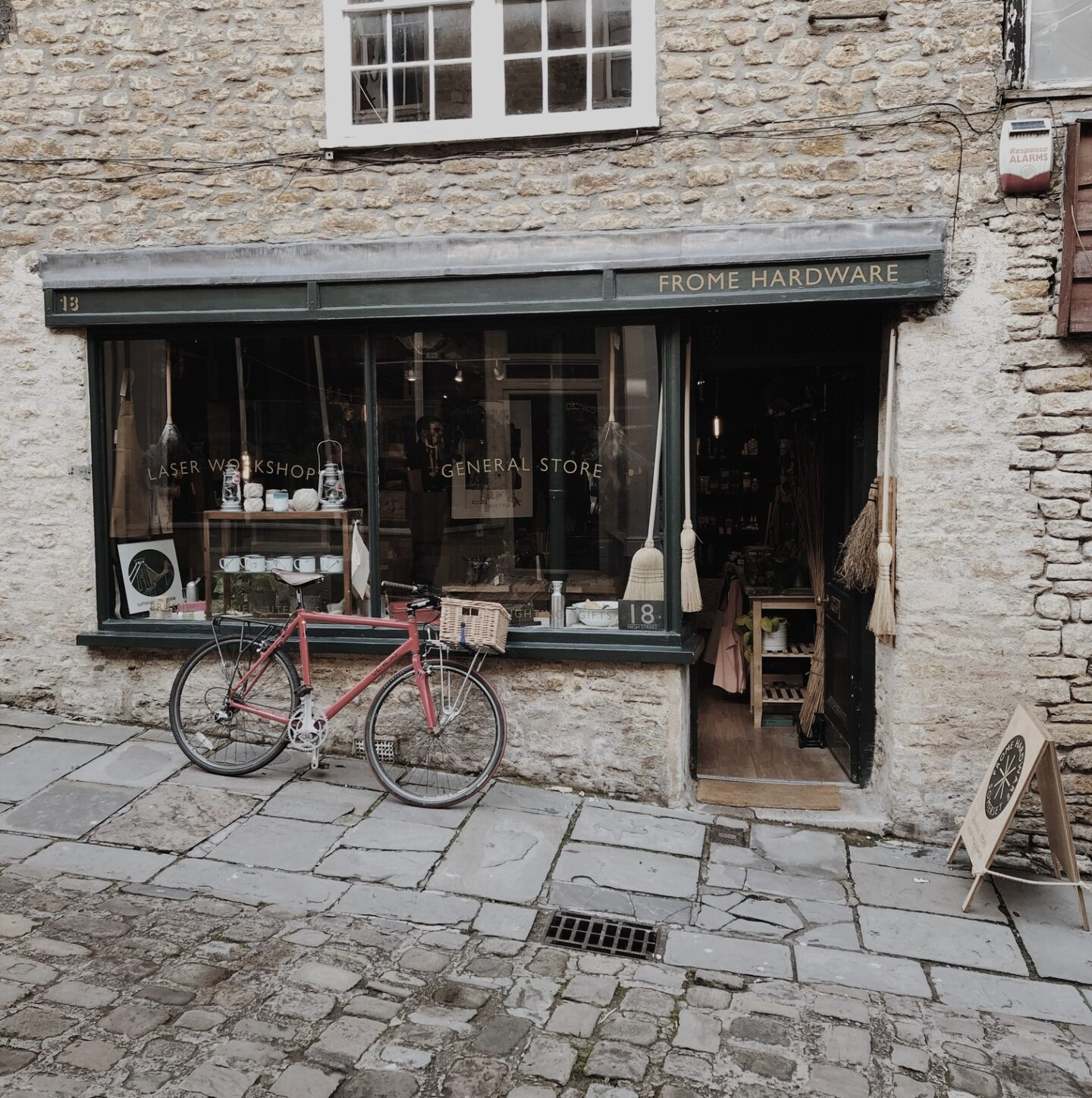 Facade of Frome Hardware with a red bicycle outside