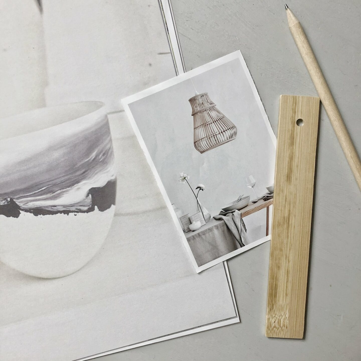 Flatlay on grey background of magazine clippings