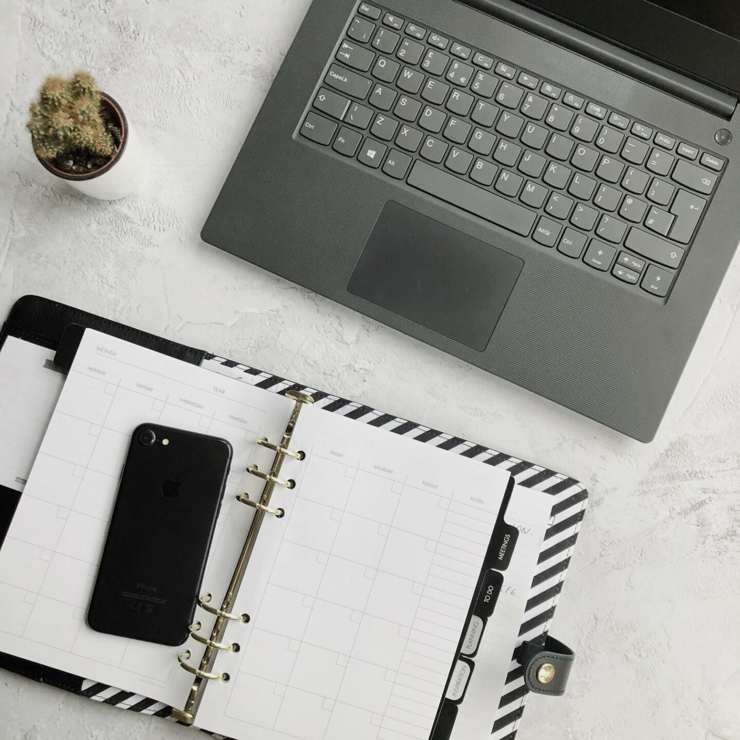 Home office: laptop and notebooks on grey background