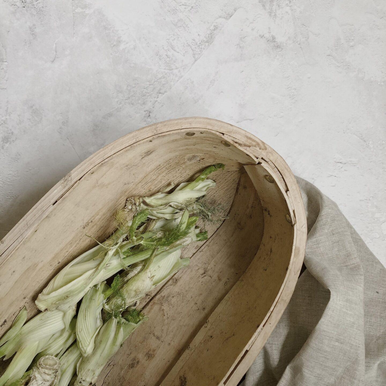 Wooden garden trug filled with fennel