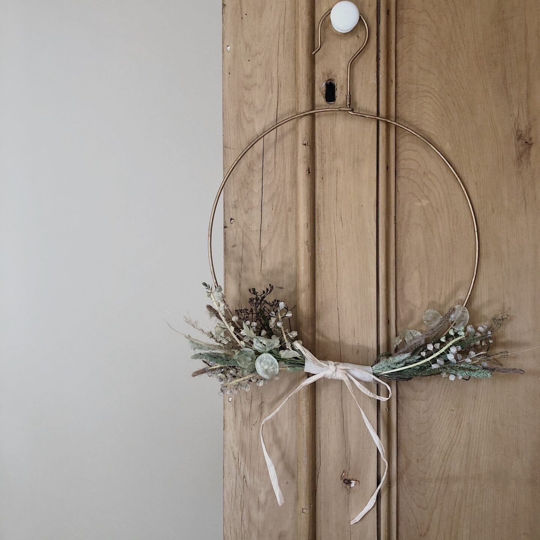 Dried flower wreath on a wire hoop